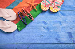 Summer vacation concept on blue wooden background - top view stock photos