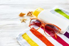 Summer vacation concept. colorful towel, sunglasses, yellow suns Stock Photos