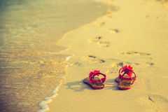 Summer vacation concept--Flipflops on a sandy  beach Stock Photo