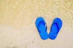 Summer vacation concept--Flipflops on a sandy ocean beach. Stock Images