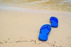 Summer vacation concept--Flipflops on a sandy ocean beach. Stock Photo