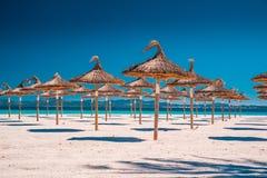Summer vacation concept photo. Umbrellas on a tropical beach. Summer vacation concept photo
