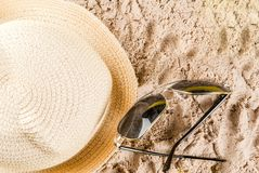 Summer vacation concept. Bright yellow background with hat, sun glasses Stock Images