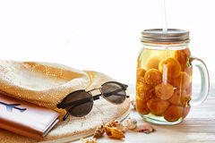 Summer vacation concept. yellow cocktail juice with apricot, hat Royalty Free Stock Images