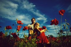 Summer vacation. couple in poppy field of man and woman Royalty Free Stock Images
