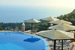 Summer vacation destination. Swimming pool and horizon Stock Photos