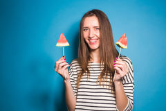 Summer, vacation, diet and vegans concept - Beautiful smiling young woman holding watermelon slice on stick Royalty Free Stock Photography