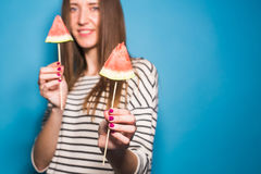 Summer, vacation, diet and vegans concept - Beautiful smiling young woman holding watermelon slice on stick Stock Images