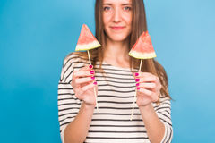 Summer, vacation, diet and vegans concept - Beautiful smiling young woman holding watermelon slice on stick Stock Photo