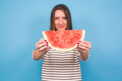 Summer, vacation, diet and vegans concept - Beautiful smiling young woman holding watermelon.  Royalty Free Stock Photo