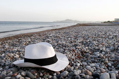 Summer vacation - at dusk. Summer vacation accessories - hat and sunglasses at dusk stock photos