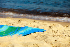 Summer vacation. Empty blue green mat on the beach Royalty Free Stock Photography