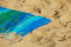 Summer vacation. Empty blue green mat on the beach Stock Image