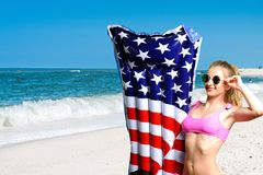 Woman in bikini with inflatable mattress ice cream on the beach. Royalty Free Stock Images