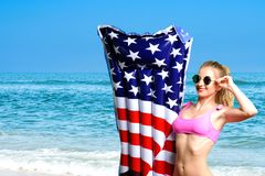 Woman in bikini with inflatable mattress ice cream on the beach. Royalty Free Stock Photography