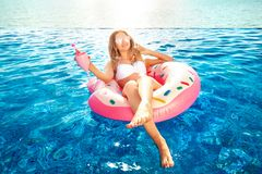 Summer Vacation. Woman in bikini on the inflatable donut mattress in the SPA swimming pool. Travel to the sea rest. Summer Vacation. Enjoying suntan Woman in royalty free stock photos