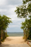 Summer vacation. Entrance to a sandy beach. Seascape. Royalty Free Stock Image