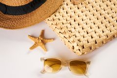 Summer vacation essentials on a white background Royalty Free Stock Photo