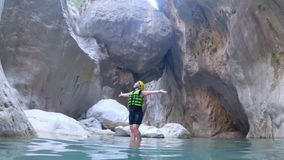 Summer vacation extreme excursion, cheerful tourist young woman in protective helmet and life jacket enjoys her sports. Weekend and active tour in mountains on stock video