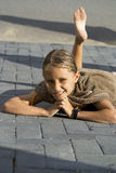 Summer Vacation Fun. Child playing in the driveway with costumes and towel Royalty Free Stock Photo