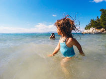 Summer vacation fun. Children playing in sea having fun during summer vacation Royalty Free Stock Photo