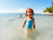 Summer vacation fun. Children playing in sea having fun during summer vacation Royalty Free Stock Image