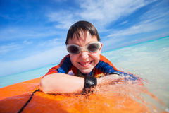 Summer vacation fun. Little boy on vacation having fun swimming on boogie board Royalty Free Stock Photo
