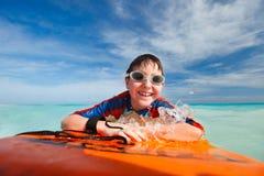 Summer vacation fun. Little boy on vacation having fun swimming on boogie board Stock Photo
