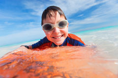 Summer vacation fun. Little boy on vacation having fun swimming on boogie board Stock Images