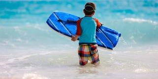 Summer vacation fun. Little boy on vacation having fun swimming on boogie board Stock Image
