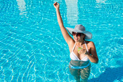 Summer vacation fun and relax in hotel pool Stock Photos