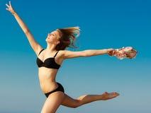 Summer vacation. Girl in bikini running on beach Royalty Free Stock Image