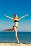 Summer vacation. Girl in bikini running on beach stock photos