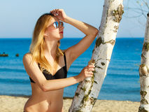 Summer vacation. Girl in bikini standing on beach Stock Photo