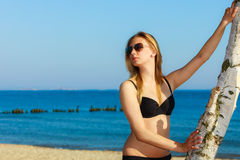Summer vacation. Girl in bikini standing on beach Royalty Free Stock Photography