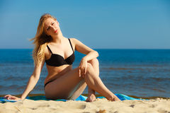 Summer vacation Girl in bikini sunbathing on beach Royalty Free Stock Photo
