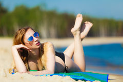 Summer vacation Girl in bikini sunbathing on beach Royalty Free Stock Images