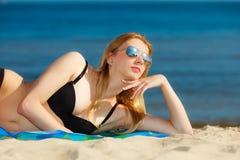 Summer vacation Girl in bikini sunbathing on beach Stock Image