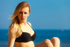 Summer vacation Girl in bikini sunbathing on beach Stock Photography