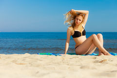 Summer vacation Girl in bikini sunbathing on beach Royalty Free Stock Photos