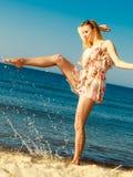 Summer vacation. Girl having fun on the sea coast stock photography