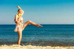Summer vacation. Girl having fun on the sea coast Royalty Free Stock Images