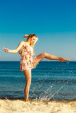 Summer vacation. Girl having fun on the sea coast Royalty Free Stock Photography