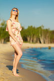 Summer vacation. Girl standing alone on the beach. Royalty Free Stock Photography