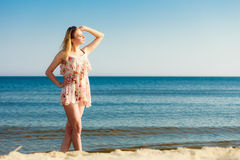 Summer vacation. Girl standing alone on the beach. Royalty Free Stock Images
