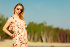 Summer vacation. Girl standing alone on the beach. Royalty Free Stock Image
