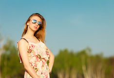 Summer vacation. Girl standing alone on the beach. Stock Image