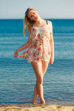 Summer vacation. Girl walking alone on the beach. royalty free stock photography