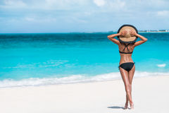 Summer vacation happiness carefree sun hat woman. Summer vacation happiness carefree joyful woman standing on white sand enjoying tropical beach destination stock photo