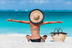 Summer vacation happy beach woman enjoying holiday. Summer vacation happy carefree joyful bikini woman arms outstretched in happiness enjoying tropical beach stock image